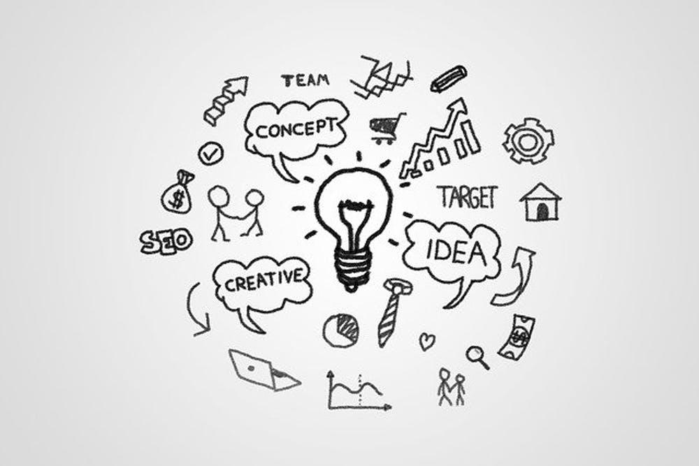 Lightbulb with strategic words and symbols surrounding it